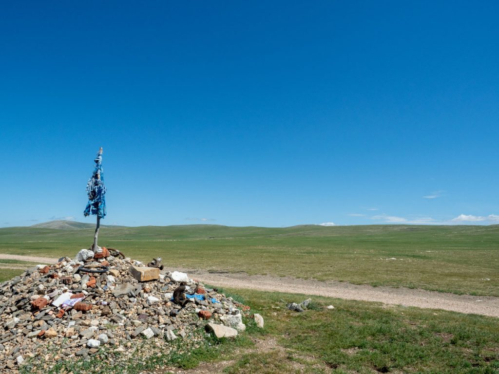 Mongolian cairn with blue khadags