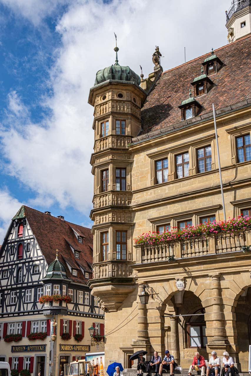 Gothic/Renaissance building and half-timbered house