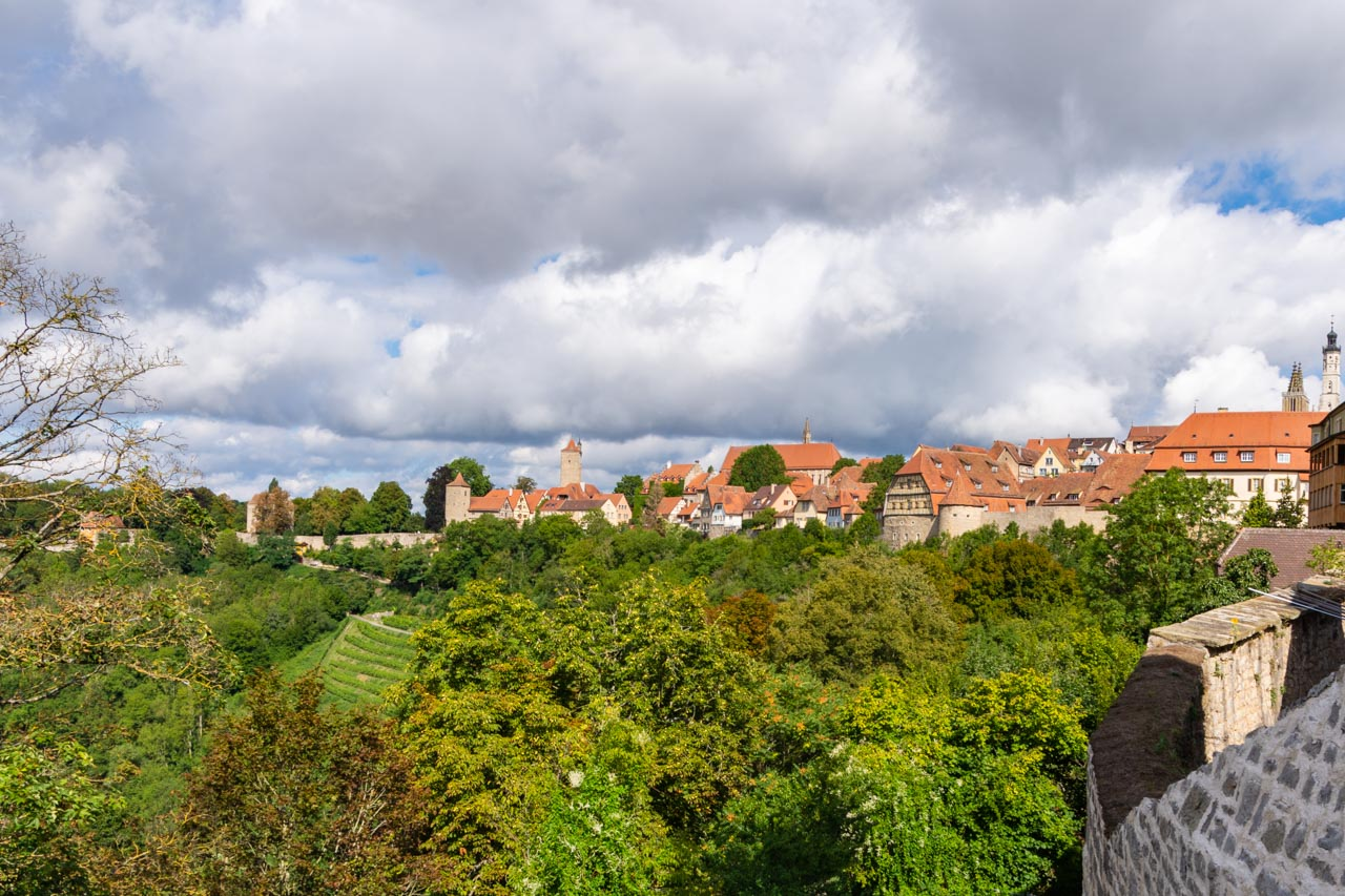 Red roofed houses enclosed by Rothenburg's fortifications