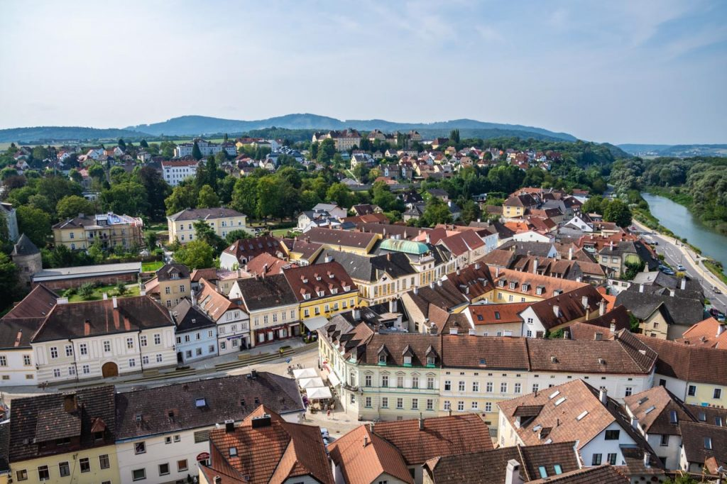 Looking down on a town and river from Melk Abbey