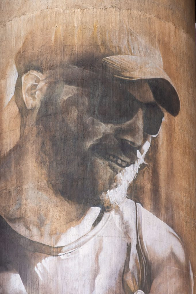 Sepia-coloured painting of young man on a concrete grain