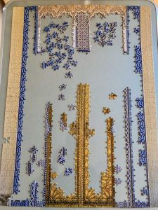 An unfinished jigsaw puzzle on a table