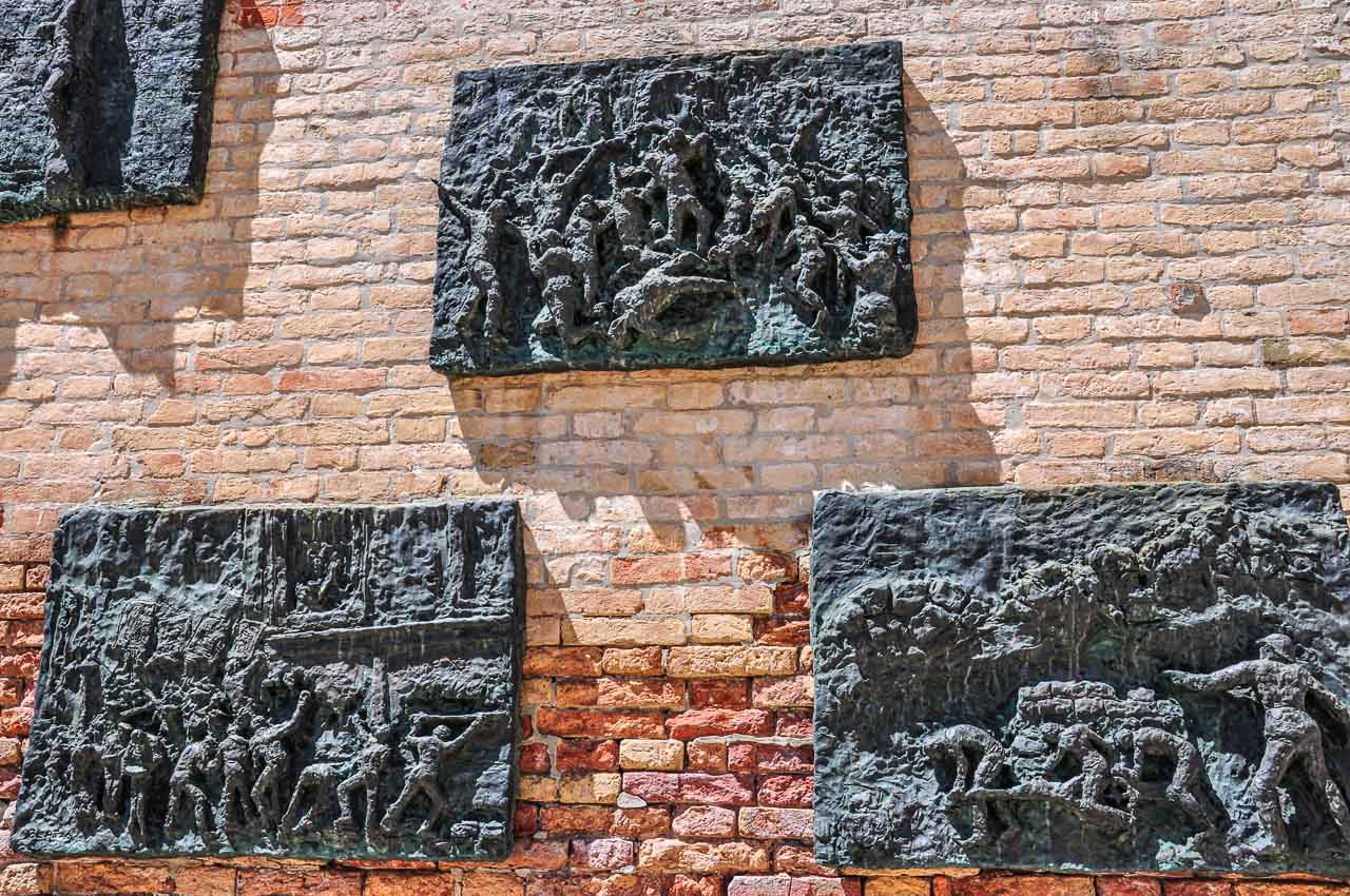 Bronze plates on a brick wall