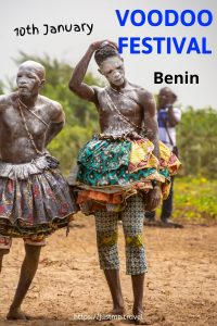 Two male Voodoo devotees dressed in multi-layered skirts