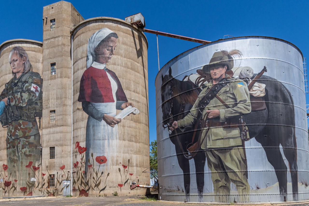 Female military medic, First World War nurse and First World War soldier and horse painted on silos