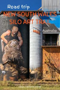 Painting on a concrete silo of a shearer shearing a sheep