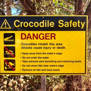 A crocodile danger sign telling how to be croc safe around water