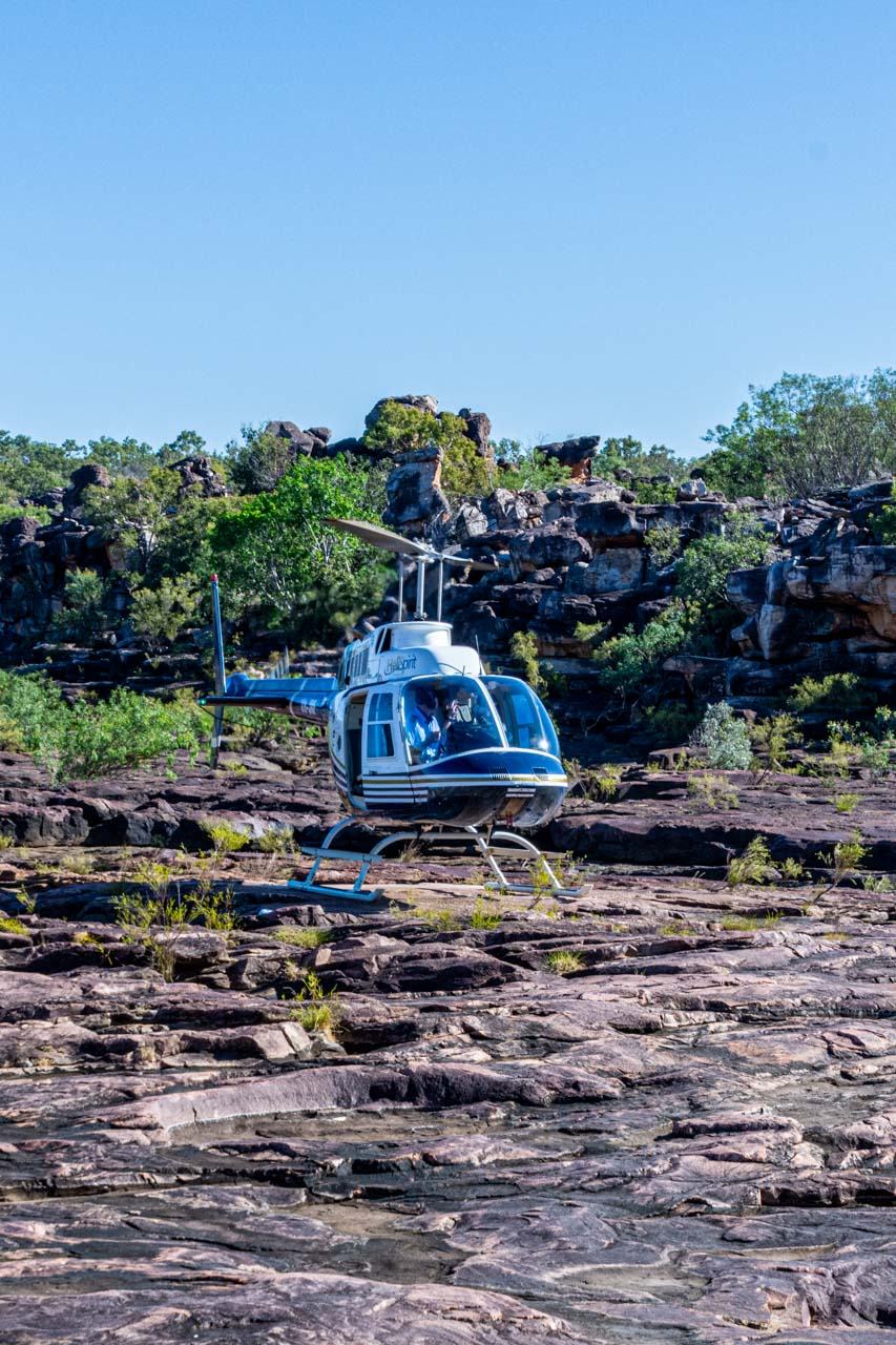 A helicopter siting on a rocky plateau