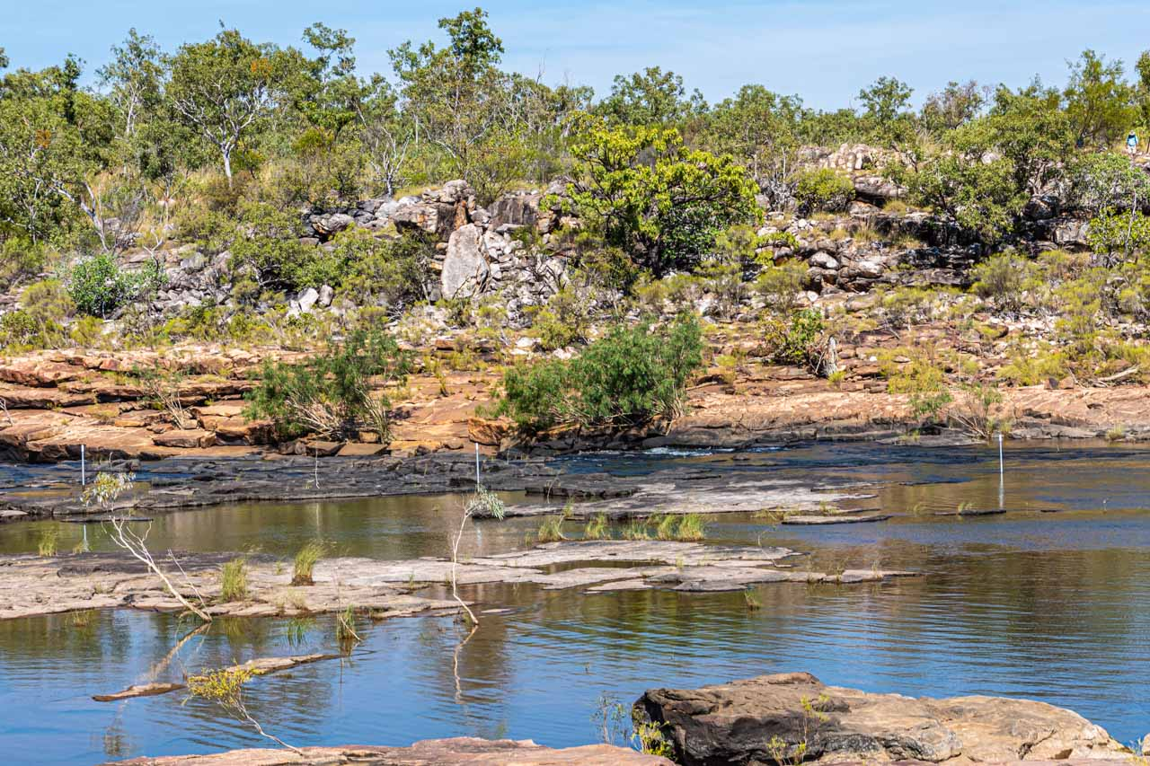 A river with rocky riverbanks and rocks in the river
