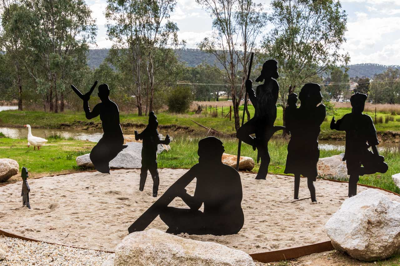Flat metal figures sitting in a circle, representing a family