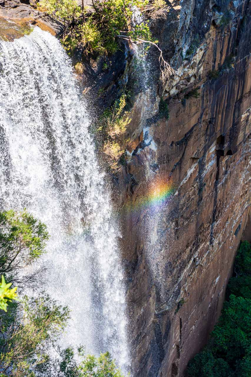 A waterfall with rainbow