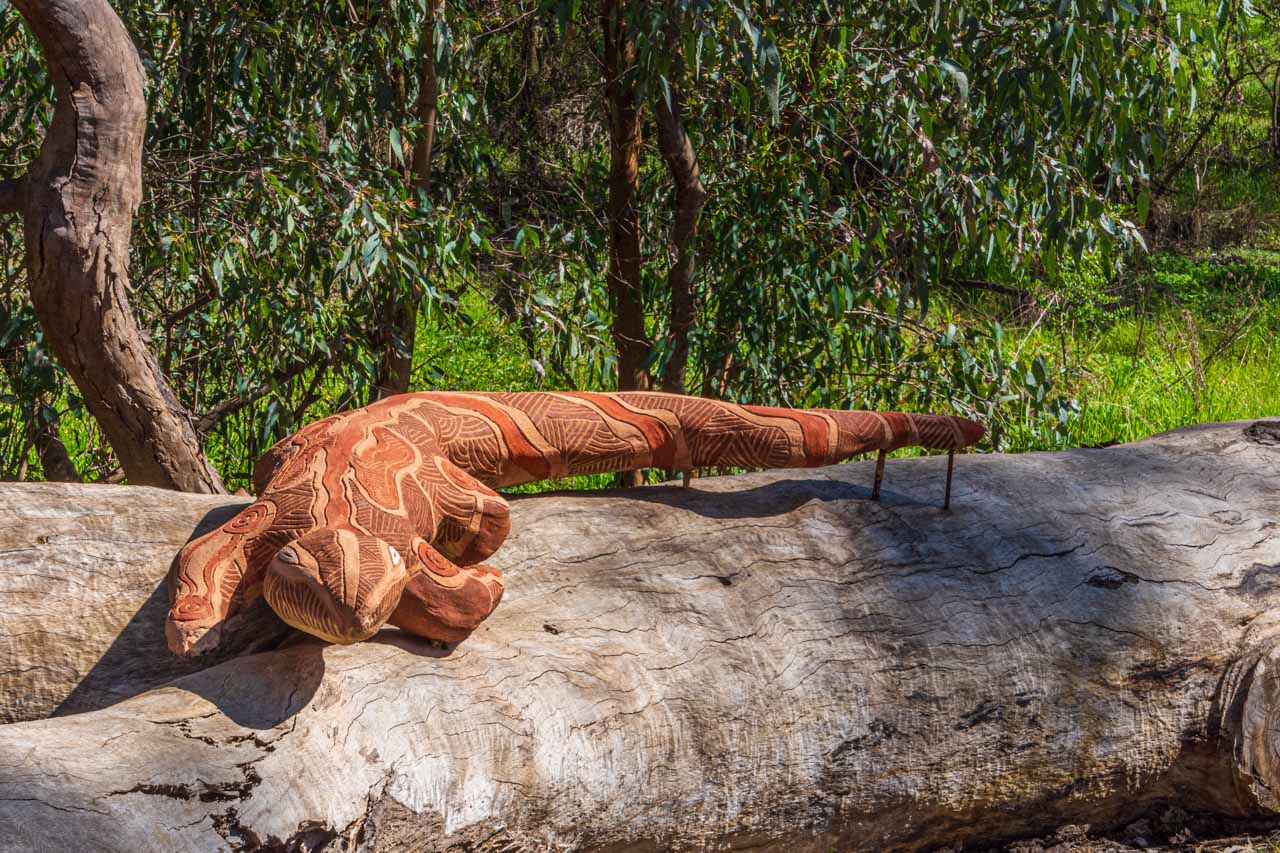 A photo of a concrete sculpture of a goanna