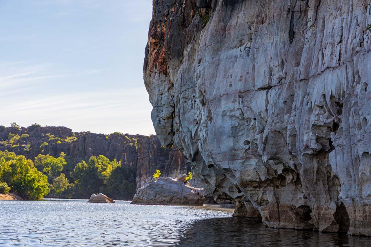 Jagged cliffs along a water course